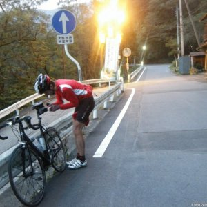 Ludwig taking time fixing his saddle bag thingy (6am, Shima-onsen)