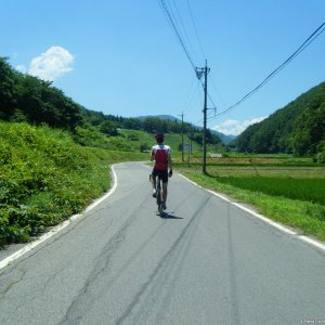 Ludwig stretching his back on a scorching hot Nagano country road